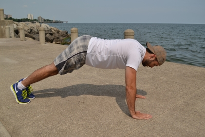 The hips are too high. It is a common mistake with the pushup. Be sure to straighten the body and engage the core.